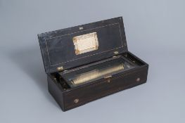 A Swiss marquetry wooden 8-air cylinder music box, 19th C.