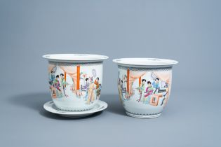 A pair of Chinese famille rose jardinieres with figures in an interior and a stand, Republic, 20th C