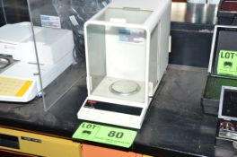 OHAUS ANALYTICAL BALANCE SCALE WITH DRAFT SHIELD, S/N N/A [RIGGING FEE FOR LOT #80 - $25 USD PLUS