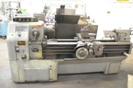 """OKUMA LS ENGINE LATHE WITH 24"""" SWING, 60"""" BETWEEN CENTERS, 1.5"""" SPINDLE BORE, 8"""" 3-JAW CHUCK, SPEEDS"""
