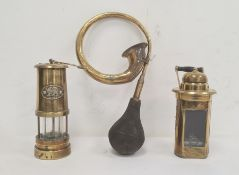 Welsh brass Davey-type miner's lamp,another brass and glass lampand a brass carved horn (3)