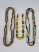 Agate and green stone necklace, amber-type necklace and another (3)  Condition ReportPlease see