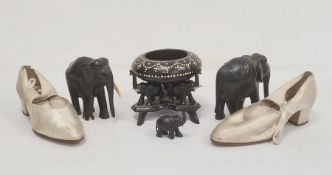 Pair early 20th century lady's satin shoes, ebony elephantsand elephant bowl and stand