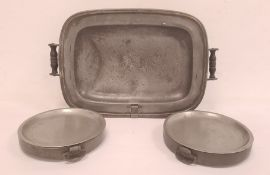 Nineteenth century large pewter hot platewith wooden handles and two antique pewter circular