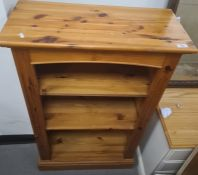 Modern pine open bookcaseon plinth base, 66 x 109cm