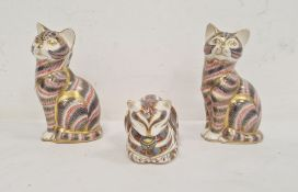 Two Royal Crown Derby seated cat paperweights and another cat lying down (3)Condition Reportthere is