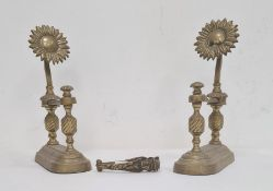 Pair of brass sunflower pattern firedogs, each with spiral turned columns and a pair of Fagin & Bill