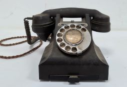 Black bakelite telephone, no.5088(?) and numbered 312F.P.X54/3A