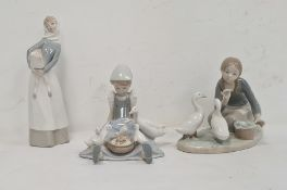 Lladro figure of a girl carrying lamb, 28cm high approx, another of girl seated with duck and