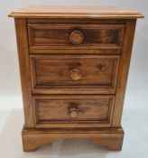 Modern stained oak bedside chest of drawers