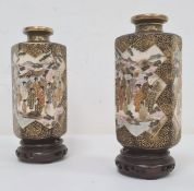 Pair of Japanese Satsuma vasesof hexagonal panelled form, each decorated with a panel of seated