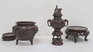 Japanese bronze vaseof bulbous circular form, the body decorated with birds on fruiting branches in