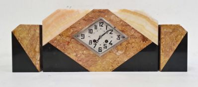 Art Deco style clock garniture in polished hardstone, the diamond-shaped dial with Arabic numerals