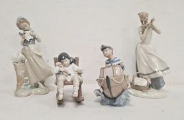 Lladro figure of girl with two doves, another of boy with boat, another of girl with doll in rocking