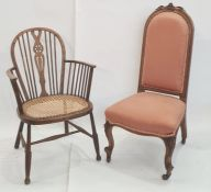 Late Victorian chair with carved top rail, upholstered seat and back, cabriole legs terminating to