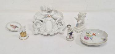 Meissen white porcelain cherub group, damaged, Nymphenburg porcelain lion with shield, Rosenthal cat