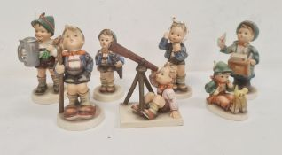 Seven various Hummel figures including boy with telescope, boy with letters and boy with turnips and