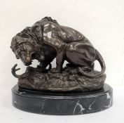 After Antoine-Louis Barye bronze modelof a lion and serpent, on oval veined marble base, 25cm high