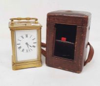 Brass and glass carriage clock with Roman numerals to the dial, in carry case  Condition