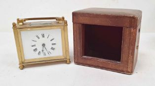 Brass and glass carriage clock of squat form, with Roman numerals to the dial, in carry case