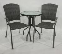 Circular glass topped garden table and two chairs (3)