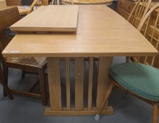 20th century light oak extending dining table on pillar end supports