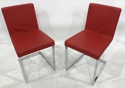 Set of four modern cantilever chairs on chrome bases, red leather seats and backs (4)