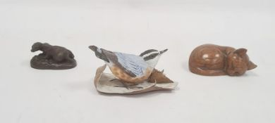 Brooks and Bentley bisque china model bird with leaves, carved wooden model cat and a bronze