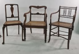 Five assorted chairs to include cane seated spindle back chair, rush seated chair, wheelback chair