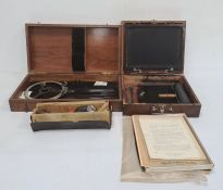 Ellams duplicatorin stained wood case,a vintage metal surveyors toolin stained wood box and a
