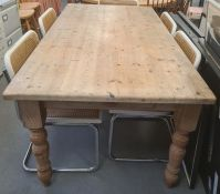 20th century pine-topped rectangular table on turned supports, peg feet, the top 90 x 164cm
