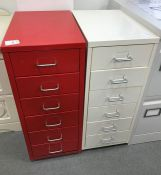 Six-drawer white painted metal filing cabinet and one red one (2)