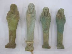 Four Egyptian blue glazed faience Ushabti in typical mummified form, one with swing label