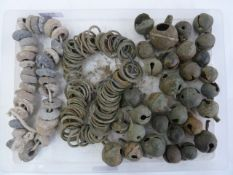 Quantity of medieval lead spindle-whorles, bronze crottle bells and rings