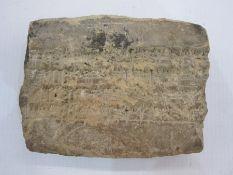 Babylonianterracotta cuneiform fragment, 7cm x 9cm with accompanying written inscription '