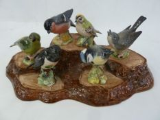 12 various Beswick small model birdsto include kingfisher and a Beswick ceramic bark-pattern five-