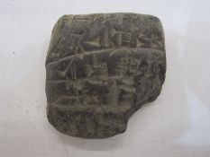 Small cuneiform pottery accounts tablet, circa 200BC, with accompanying written inscription 'Small