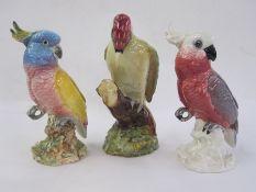Three Beswick models viz:-no.1218 woodpecker, no.1180 cockatoo in shades of pink and white and no.