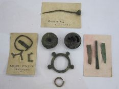 Collection of Roman and Iron Age bronze objects to include terret ring, Roman bronze pin,