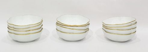 Set of 12 Raynaud limited white porcelain lobed dessert bowls with gilt borders (12)