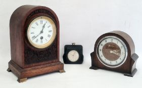 20th century oak arch topped mantel clock with roman numerals to the enamel dial, further 20th