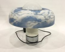 Large 1970's plastic table lampwith circular shade of blue sky and clouds, on cylindrical base with