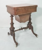 Victorian walnut games/work table, the rectangular swivel top with rounded front corners, opening to