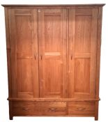 Pair of modern oak three-door wardrobeson bases with two drawers (2) Condition ReportYes the