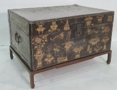 Chinese gilt decorated and lacquered leather trunk on stand, 19th century and later, 83cm x 54cm (ex