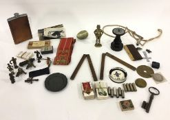 Two antique brass-bound wood folding rulers, small brass figure of John Bull, other miniature