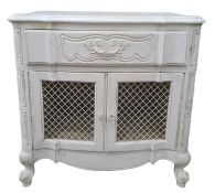 20th century white painted cupboard, the shaped top above single drawer, two grilled cupboard doors,