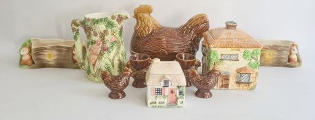 Two Eastgate pottery fauna pattern flower troughs, a Beswick cottage biscuit barrel, a hen covered