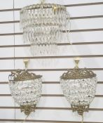 Cut glass three-tier wall light bracket, demi-lune-shaped and graduating, with cut prismatic