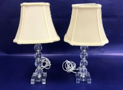 Pair cut glass and chrome table lamps, each with four faceted knops to the column, on square